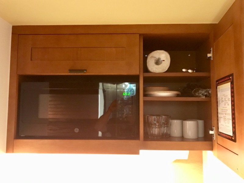 Kitchenette upper cabinet including microwave