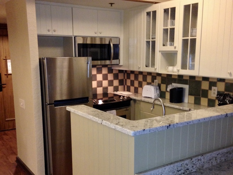 Kitchen highlighting refrigerator, stove and microwave