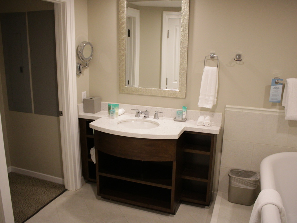 Master bathroom vanity, walk-in closet (right) and tub (left)