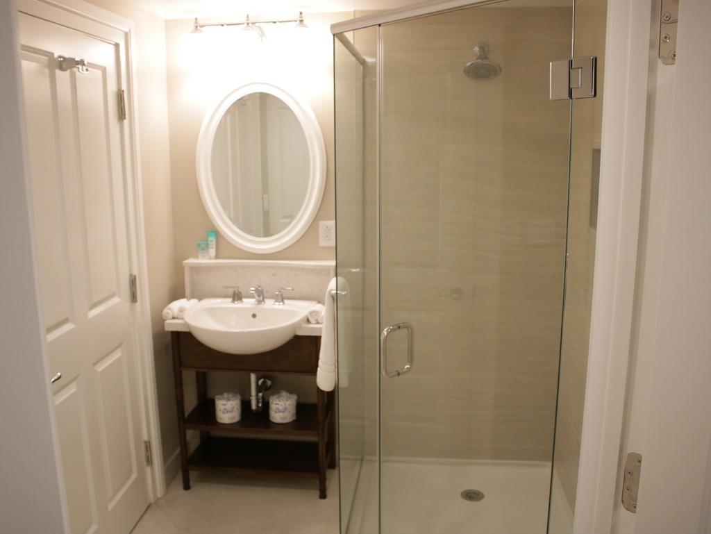 Second vanity and shower stall