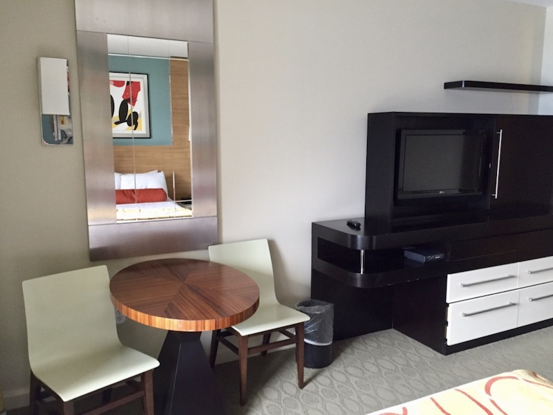 TV, armoire and side table with chairs