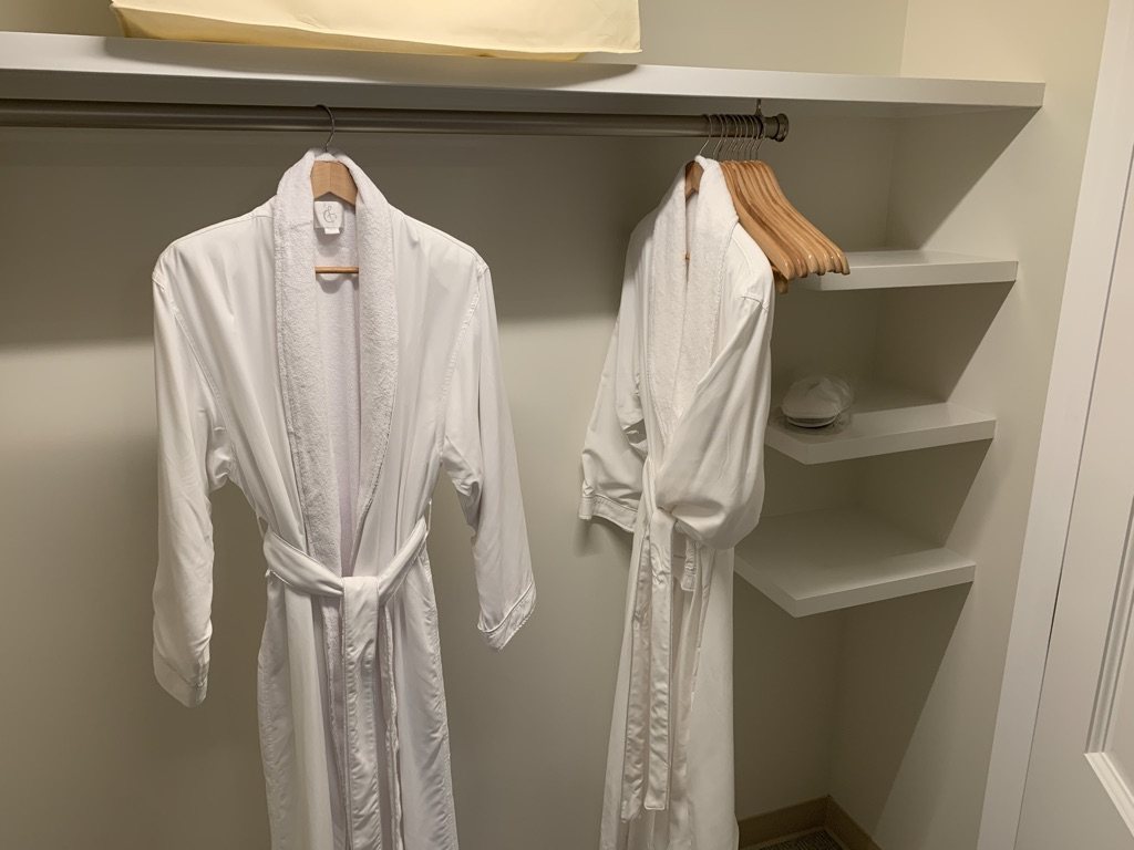 Master bedroom closet with robes