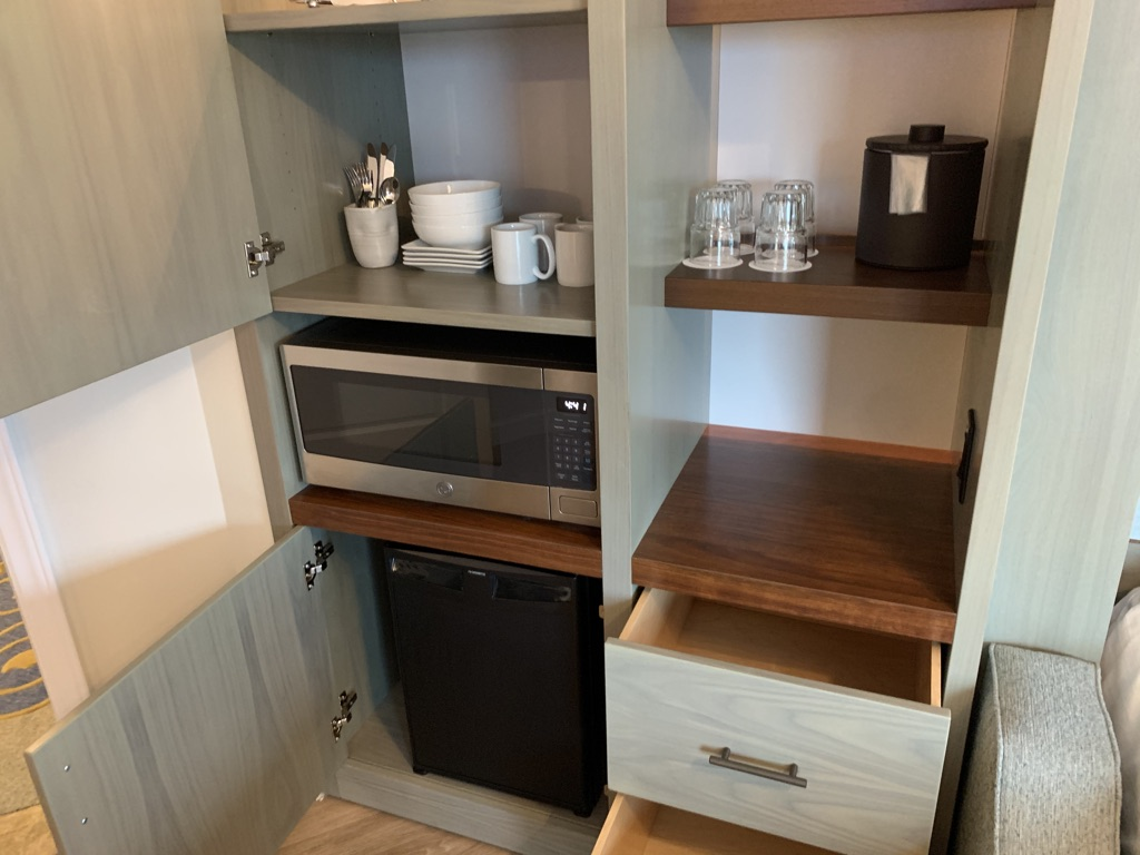 Left side storage panel with fridge, microwave and dishes
