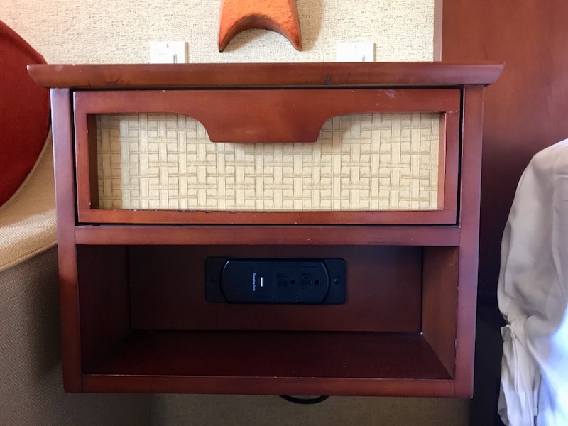 Nightstand with USB charging ports visible