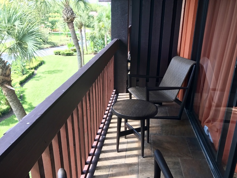 Balcony with table and two chairs