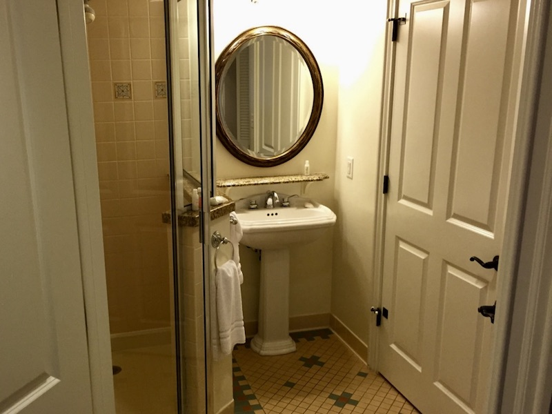Shower (left) and pedestal sink