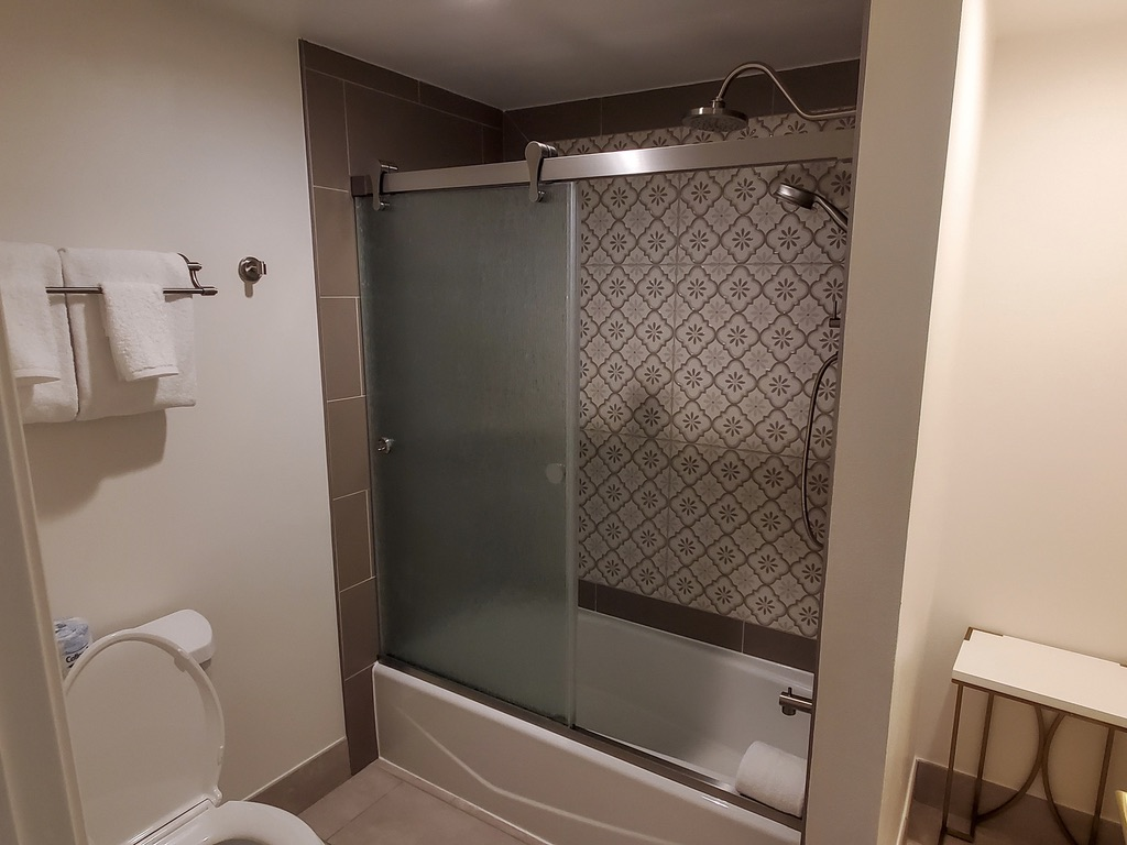 Full bathroom with tub and shower combo