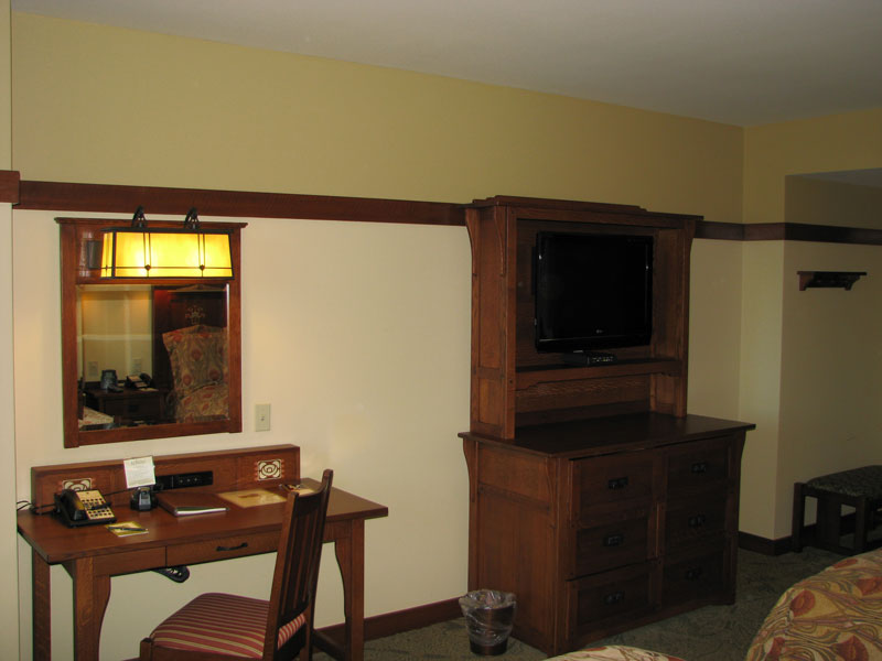TV, dresser, side table with two chairs (opposite angle)
