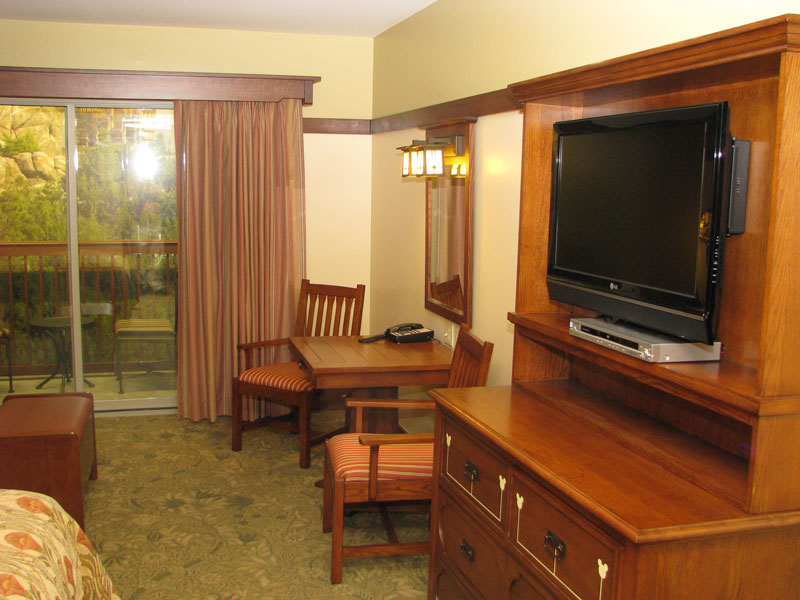 TV, dresser, side table with two chairs
