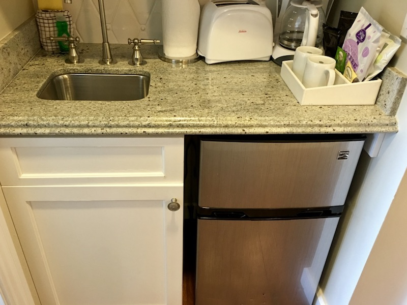 Kitchenette counter, sink and mini fridge
