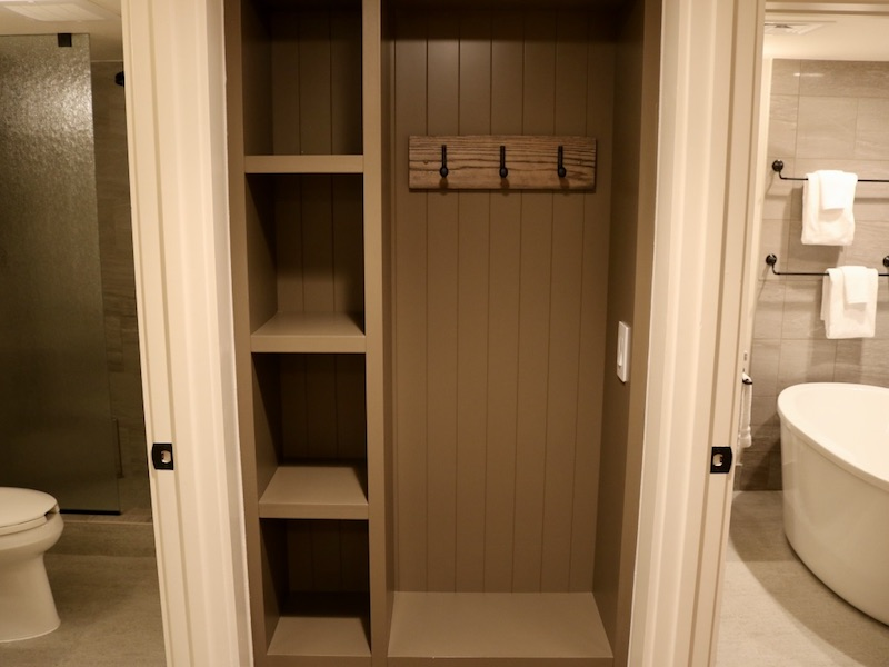 Hallway storage with split master bathroom visible